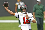 Tampa Bay Buccaneers quarterback Tom Brady (12) throws a pass before an NFL football game against the Green Bay Packers Sunday, Oct. 18, 2020, in Tampa, Fla. (AP Photo/Mark LoMoglio)
