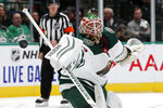 Minnesota Wild goaltender Alex Stalock (32) deflects a shot from the Dallas Stars in the first period of an NHL hockey game in Dallas, Tuesday, Oct. 29, 2019. (AP Photo/Tony Gutierrez)