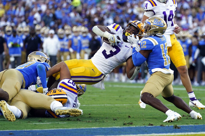 LSU running back Tyrion Davis-Price (3) is stopped short of the goal line by UCLA defensive back Martell Irby (12) during the first half of an NCAA college football game Saturday, Sept. 4, 2021, in Pasadena, Calif. (AP Photo/Marcio Jose Sanchez)