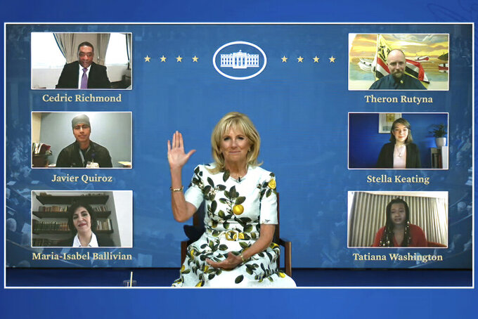In this image from video provided by The White House, first lady Jill Biden waves to her virtual guests on Wednesday, April 28, 2021, ahead of the joint session of Congress and President Joe Biden's speech in Washington.  Guests watching virtually will include, Javier Quiroz Castro, Maria-Isabel Ballivian, Tatiana Washington, Stella Keating, and Theron Rutyna. (White House via AP)