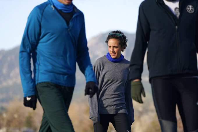Olympic hopeful Maggie Montoya is shown as she trains with fellow runners at a park on the east side of Boulder, Colo., Friday, April 9, 2021.   The Olympic hopeful was working in the pharmacy at the King Soopers supermarket in Colorado on March 22 when 10 people were killed in the mass shooting. (AP Photo/David Zalubowski)