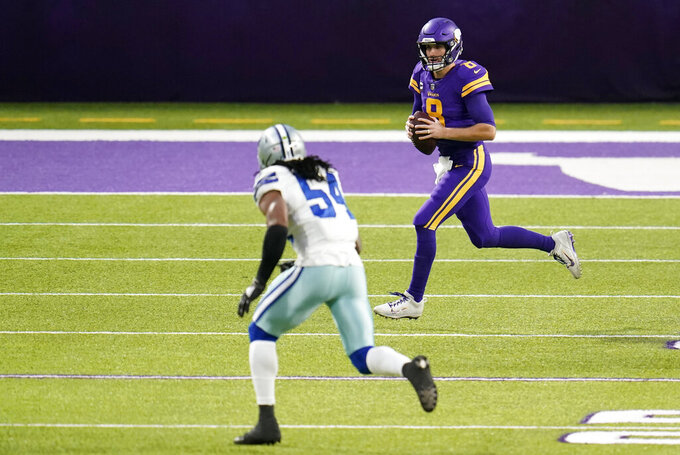 Minnesota Vikings quarterback Kirk Cousins (8) scrambles up field in front of Dallas Cowboys linebacker Jaylon Smith (54) during the first half of an NFL football game, Sunday, Nov. 22, 2020, in Minneapolis. (AP Photo/Jim Mone)