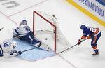 New York Islanders defenseman Devon Toews (25) scores on Tampa Bay Lightning goaltender Andrei Vasilevskiy (88) during the first period of Game 6 of the NHL hockey Eastern Conference final, Thursday, Sept. 17, 2020, in Edmonton, Alberta. (Jason Franson/The Canadian Press via AP)
