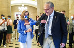 House Speaker Nancy Pelosi of Calif., gives Senate Minority Leader Chuck Schumer of N.Y., an elbow bump as Schumer leaves following a meeting at the Capitol with White House chief of staff Mark Meadows and Treasury Secretary Steven Mnuchin on a COVID-19 relief bill, Saturday, Aug. 1, 2020, in Washington. (AP Photo/Manuel Balce Ceneta)