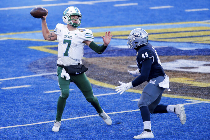 FILE - In this Dec. 22, 2020, file photo, Tulane quarterback Michael Pratt (7) looks to throw the ball as Nevada linebacker Trevor Price (45) closes in during the second half of the Famous Idaho Potato Bowl NCAA college football game in Boise, Idaho. Pratt and Tulane face Oklahoma this weekend in a game moved from New Orleans because of Hurricane Ida. (AP Photo/Steve Conner, File)