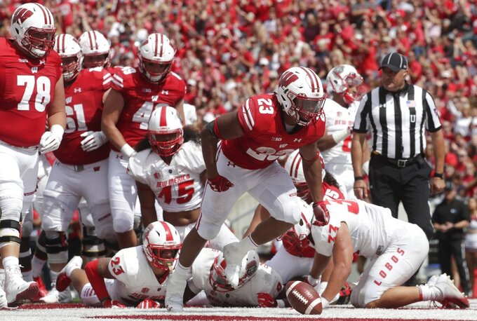 Taylor scores 3 TDs, No. 5 Wisconsin beats New Mexico 45-14