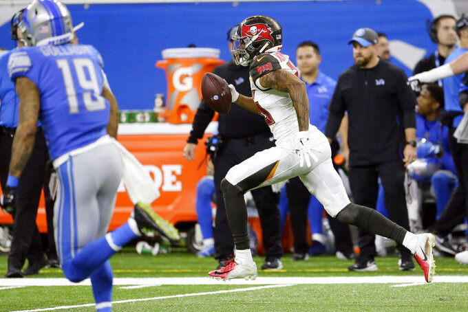 Tampa Bay Buccaneers defensive back Sean Murphy-Bunting returns an interception for a 70-yard touchdown during the second half of an NFL football game against the Detroit Lions, Sunday, Dec. 15, 2019, in Detroit. (AP Photo/Duane Burleson)