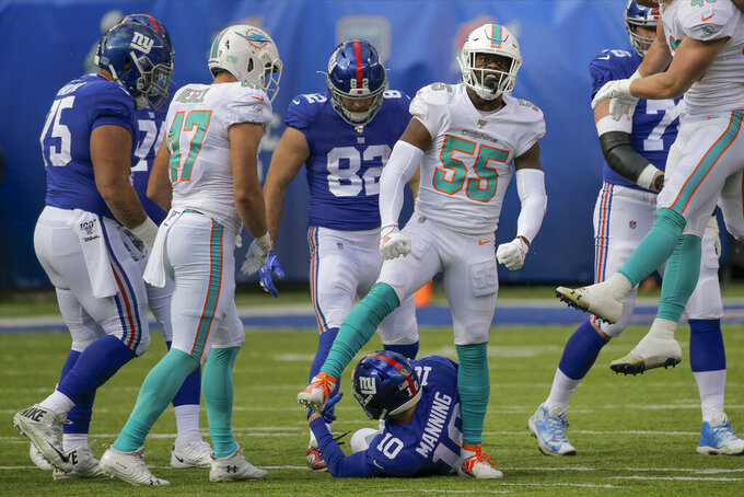 Miami Dolphins outside linebacker Jerome Baker (55) reacts after sacking New York Giants quarterback Eli Manning (10) during the first quarter of an NFL football game, Sunday, Dec. 15, 2019, in East Rutherford, N.J. (AP Photo/Seth Wenig)