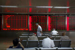 Chinese investors monitor stock prices at a brokerage house in Beijing, Thursday, June 27, 2019. Asian stocks advanced Thursday ahead of a meeting between U.S. President Donald Trump and Chinese leader Xi Jinping at the G-20 summit in Japan this week. (AP Photo/Andy Wong)