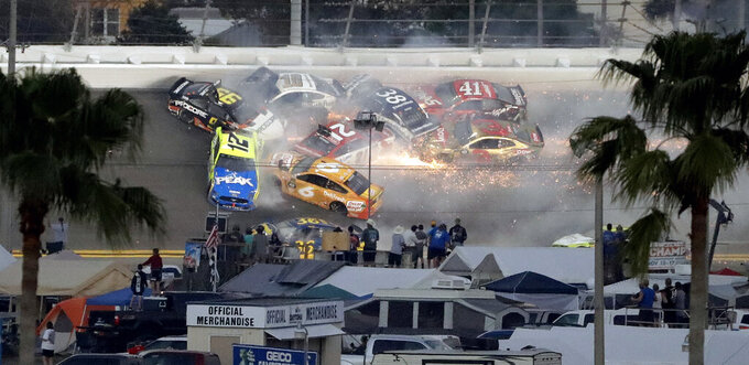 Multiple cars, including Austin Dillon (3), Daniel Suarez (41), David Ragan (38), Paul Menard (21), Ryan Newman (6), Aric Almirola (10), Matt DiBenedetto (95) and Ryan Blaney (12) crash during a NASCAR Daytona 500 auto race Sunday, Feb. 17, 2019, at Daytona International Speedway in Daytona Beach, Fla. (AP Photo/Chris O'Meara)