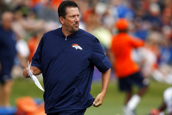 FILE - In this Aug. 4, 2016, file photo, Denver Broncos quarterbacks coach Greg Knapp watches during NFL football training camp in Englewood, Colo. Knapp, an assistant coach with the New York Jets, died Thursday, July 22, 2021, of injuries suffered in a bicycle accident near his home in California last Saturday. He was 58. Knapp's family released a statement through the team that the longtime NFL assistant coach had died. (AP Photo/David Zalubowski, File)