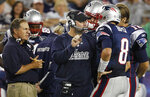 FILE - In this Aug. 11, 2011, file phoot, New England Patriots offensive coordinator Bill O'Brien, center, talks on the sidelines with quarterbacks Brian Hoyer (8) and Tom Brady (12) as head coach Bill Belichick, left, looks on during the second quarter of an NFL preseason football game against the Jacksonville Jaguars in Foxborough, Mass. While Belichick owns a record six Super Bowl championship rings, his former New England assistants have combined for one playoff victory as head coaches.(AP Photo/Elise Amendola, File)