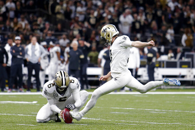 New Orleans Saints kicker Wil Lutz (3) kicks a field goal as Thomas Morstead (6) holds in the first half of an NFL wild-card playoff football game against the Minnesota Vikings, Sunday, Jan. 5, 2020, in New Orleans. (AP Photo/Brett Duke)