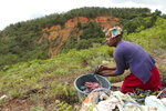 A woman does her laundry near a mountain where a mudslide caused by Cyclone Idai killed several people in Chimanimani about 600 kilometres south east of Harare, Zimbabwe, Tuesday March 19, 2019.  According to the government, Cyclone Idai has killed more than 100 people in Chipinge and Chimanimani and according to residents the figures could be higher because the hardest hit areas are still inaccessible.  Some hundreds are dead, many more are missing, and some thousands at risk from the massive flooding throughout the region of Mozambique, Malawi and Zimbabwe caused by Cyclone Idai.(AP Photo/Tsvangirayi Mukwazhi)