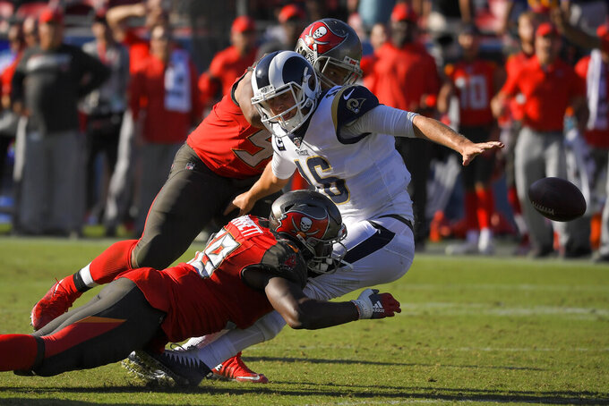 Tampa Bay Buccaneers linebacker Shaquil Barrett forces a fumble by Los Angeles Rams quarterback Jared Goff during the second half of an NFL football game Sunday, Sept. 29, 2019, in Los Angeles. The fumble was returned by a touchdown by the Buccaneers. (AP Photo/Mark J. Terrill)