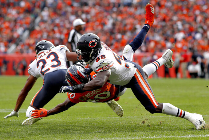 Chicago Bears inside linebacker Roquan Smith (58) stops Denver Broncos wide receiver Emmanuel Sanders (10) short of the end zone during the second half of an NFL football game, Sunday, Sept. 15, 2019, in Denver. (AP Photo/David Zalubowski)