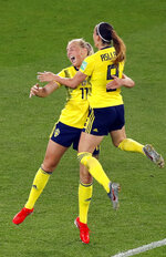 Sweden's Stina Blackstenius celebrates with Kosovare Asllani, right, after scoring the opening goal during the Women's World Cup round of 16 soccer match between Sweden and Canada at the Parc des Princes in Paris, France, Monday, June 24, 2019. (AP Photo/Michel Euler)