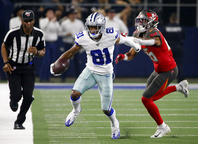 Dallas Cowboys wide receiver Jon'Vea Johnson (81) catches a pass for a first down as Tampa Bay Buccaneers defensive back Sean Murphy-Bunting (26) defends in the first half of a preseason NFL football game in Arlington, Texas, Thursday, Aug. 29, 2019. (AP Photo/Ron Jenkins)