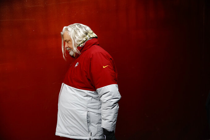 Washington Redskins linebackers coach Rob Ryan walks to the field before the first half of an NFL football game between the Washington Redskins and the New York Jets, Sunday, Nov. 17, 2019, in Landover, Md. (AP Photo/Patrick Semansky)