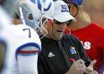 Kansas coach David Beaty talks to Peyton Bender (7) during the second half of an NCAA college football game against Texas Tech, Saturday, Oct. 20, 2018, in Lubbock, Texas. (Brad Tollefson/Lubbock Avalanche-Journal via AP)