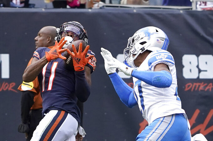 Chicago Bears wide receiver Darnell Mooney (11) catches a pass from quarterback Justin Fields as Detroit Lions defensive back Bobby Price defends during the second half of an NFL football game Sunday, Oct. 3, 2021, in Chicago. (AP Photo/David Banks)