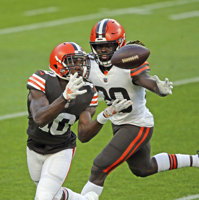 Cleveland Browns wide receiver Taywan Taylor catches a pass next to cornerback Tavierre Thomas during the NFL football team's scrimmage Friday, Sept. 4, 2020, in Cleveland. (Joshua Gunter/Cleveland.com via AP)