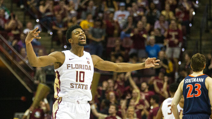 Florida State forward Malik Osborne (10) reacts to hitting a 3-point shot in the first half of the team's NCAA college basketball game against Virginia in Tallahassee, Fla., Wednesday, Jan. 15, 2020. (AP Photo/Mark Wallheiser)