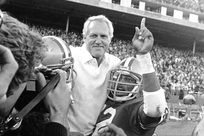 FILE - In this Nov. 29, 1981, file photo, San Francisco 49ers coach Bill Walsh is carried off the field by his team after beating the New York Giants 17-10 to clinch the division title at Candlestick Park in San Francisco. A pair of Super Bowl winning teams that launched dynasties in San Francisco and New England highlighted the list of the NFL's greatest teams, numbers 31-100. Coming in at No. 31 was the 1981 San Francisco 49ers led by coach Bill Walsh and quarterback Joe Montana. (AP Photo/Paul Sakuma, File)