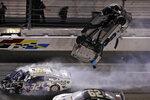 Ryan Newman (6) goes airborne after crashing into Corey LaJoie (32) during the NASCAR Daytona 500 auto race Monday, Feb. 17, 2020, at Daytona International Speedway in Daytona Beach, Fla. Sunday's running of the race was postponed by rain. (AP Photo/Chris O'Meara)