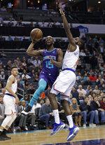 Charlotte Hornets' Kemba Walker (15) drives against New York Knicks' Tim Hardaway Jr. (3) during the first half of an NBA basketball game in Charlotte, N.C., Monday, Jan. 28, 2019. (AP Photo/Chuck Burton)
