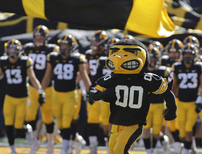 The Iowa Hawkeyes mascot runs onto the field, leading the team before the start of an NCAA college football game against Colorado State, Saturday, Sept. 25, 2021, in Iowa City, Iowa. (AP Photo/Ron Johnson)