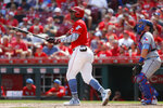 Cincinnati Reds' Yasiel Puig hits a two-run home run off Texas Rangers relief pitcher Peter Fairbanks in the fourth inning of a baseball game, Sunday, June 16, 2019, in Cincinnati. (AP Photo/John Minchillo)