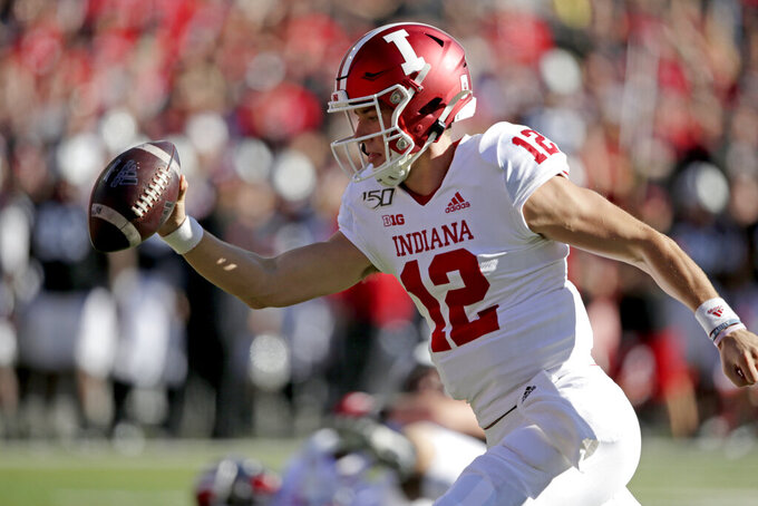 Indiana quarterback Peyton Ramsey (12) reaches with the ball to score a touchdown during the first half of an NCAA college football game against Nebraska in Lincoln, Neb., Saturday, Oct. 26, 2019. (AP Photo/Nati Harnik)