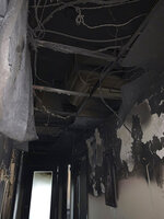 This May 31, 2020 photo provided by Sulekha Ibrahim shows the charred interior of Healing Path Wellness Services in Minneapolis, Minn., which was destroyed by a fire on May 28, 2020. In late May, Ibrahim opened the doors of the mental health clinic she runs in South Minneapolis. The clinic had been closed for weeks due to the coronavirus pandemic. She and her staff were eager to get back to work, meeting clients in person. Two days later, the clinic burned down. (Sulekha Ibrahim/Religion News Service via AP)