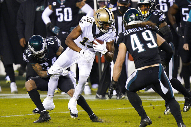 New Orleans Saints' Michael Thomas (13) is tackled by Philadelphia Eagles' Darius Slay (24) during the first half of an NFL football game, Sunday, Dec. 13, 2020, in Philadelphia. (AP Photo/Chris Szagola)
