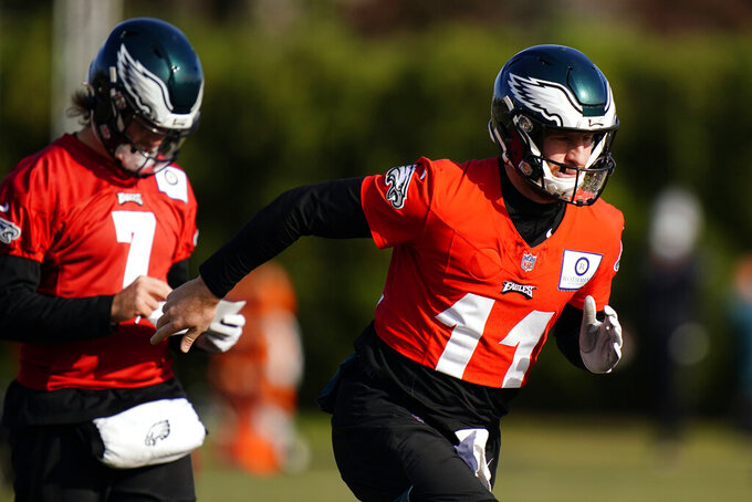 Philadelphia Eagles' Carson Wentz (11) and Nate Sudfeld (7) run between drills during practice at the NFL football team's training facility, Thursday, Nov. 19, 2020, in Philadelphia. (AP Photo/Matt Slocum, Pool)