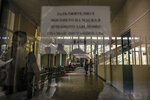 People walk in a corridor at the state hospital in Veliko Tarnovo, Bulgaria, Thursday, Sept. 2, 2021. Despite one of the European Union's highest death rates from COVID-19, and as the country faces a rapid surge of infections due to the Delta variant, people in the Balkan nation are proving the most hesitant in the 27-country bloc to get vaccinated against COVID-19. (AP Photo/Andreea Alexandru)
