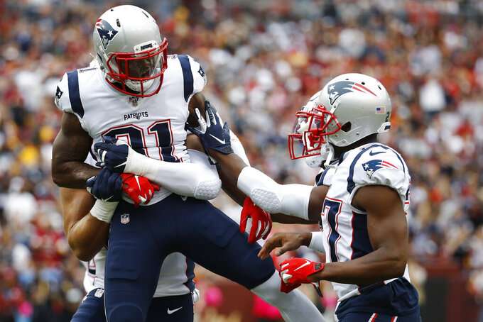 New England Patriots cornerback Jonathan Jones (31) celebrates a New England Patriots fumble recovery against the Washington Redskins during the first half of an NFL football game, Sunday, Oct. 6, 2019, in Washington. (AP Photo/Patrick Semansky)