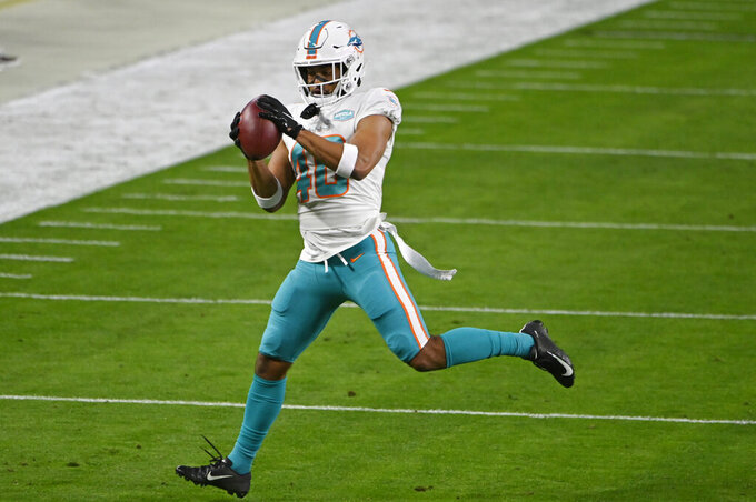 Miami Dolphins defensive back Nik Needham (40) warms up before an NFL football game against the Las Vegas Raiders, Saturday, Dec. 26, 2020, in Las Vegas. (AP Photo/David Becker)