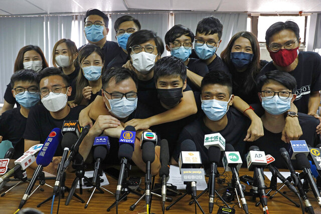 FILE - In this July 15, 2020, file photo, pro-democracy activists who were elected from unofficial pro-democracy primaries, including Joshua Wong, left, attend a press conference in Hong Kong. About 50 Hong Kong pro-democracy figures were arrested by police on Wednesday, Jan. 6, 2021 under a national security law, following their involvement in an unofficial primary election last year held to increase their chances of controlling the legislature, according to local media reports. (AP Photo/Kin Cheung, File)
