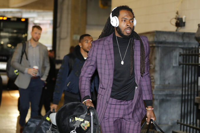 San Francisco 49ers cornerback Richard Sherman arriving with his teammates for an NFL football game against Baltimore Ravens, Sunday, Dec. 1, 2019, in Baltimore, Md. (AP Photo/Julio Cortez)