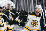 Boston Bruins' David Krejci (46) celebrates with teammates after scoring a goal during the second period of Game 4 during an NHL hockey second-round playoff series against the New York Islanders, Saturday, June 5, 2021, in Uniondale, N.Y. (AP Photo/Frank Franklin II)