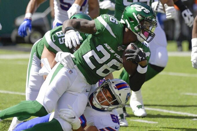Buffalo Bills' Matt Milano (58) tackles New York Jets' Le'Veon Bell (26) during the first half of an NFL football game Sunday, Sept. 8, 2019, in East Rutherford, N.J. (AP Photo/Bill Kostroun)