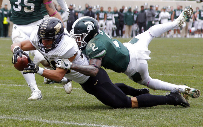 Purdue's Brycen Hopkins, left, dives for the goal line against Michigan State's Justin Layne (2) on a 30-yard pass reception during the third quarter of an NCAA college football game, Saturday, Oct. 27, 2018, in East Lansing, Mich. Hopkins was down short of the goal but Purdue scored on the next play. (AP Photo/Al Goldis)