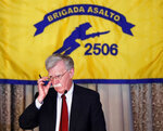 National security adviser John Bolton gestures while discussing new administration policy during a speech, Wednesday, April 17, 2019, in Coral Gables, Fla., at the Bay of Pigs Veterans Association on the 58th anniversary of the United States' failed 1961 invasion of the island, an attempt to overthrow the Cuban government. The Trump administration on Wednesday intensified its crackdown on Cuba, Nicaragua and Venezuela, rolling back Obama administration policy and announcing new restrictions and sanctions against the three countries whose leaders national security adviser John Bolton dubbed the