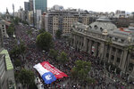Anti-government demonstrators march in Santiago, Chile, Friday, Oct. 25, 2019. A new round of clashes broke out Friday as demonstrators returned to the streets, dissatisfied with economic concessions announced by the government in a bid to curb a week of violence that began with a protest over a hike in subway fares. (AP Photo/Esteban Felix)