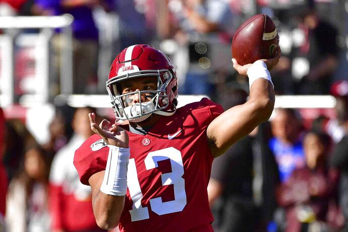 Alabama quarterback Tua Tagovailoa (13) warms up before an NCAA football game against LSU, Saturday, Nov. 9, 2019, in Tuscaloosa , Ala. (AP Photo/Vasha Hunt))