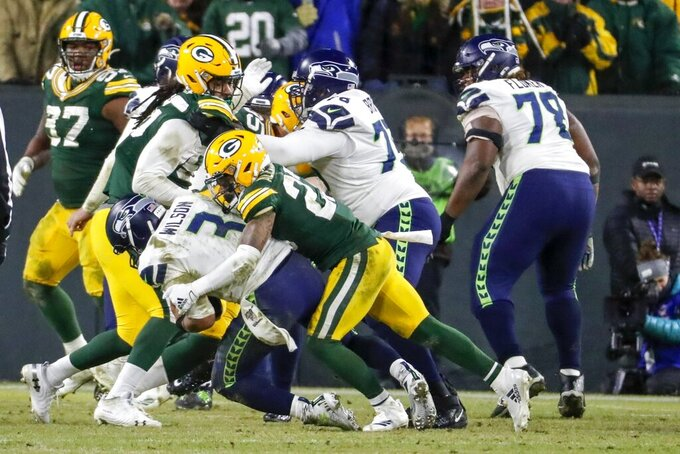 Green Bay Packers' Jaire Alexander sacks Seattle Seahawks quarterback Russell Wilson on a two-point conversion attempt during the second half of an NFL divisional playoff football game Sunday, Jan. 12, 2020, in Green Bay, Wis. (AP Photo/Matt Ludtke)