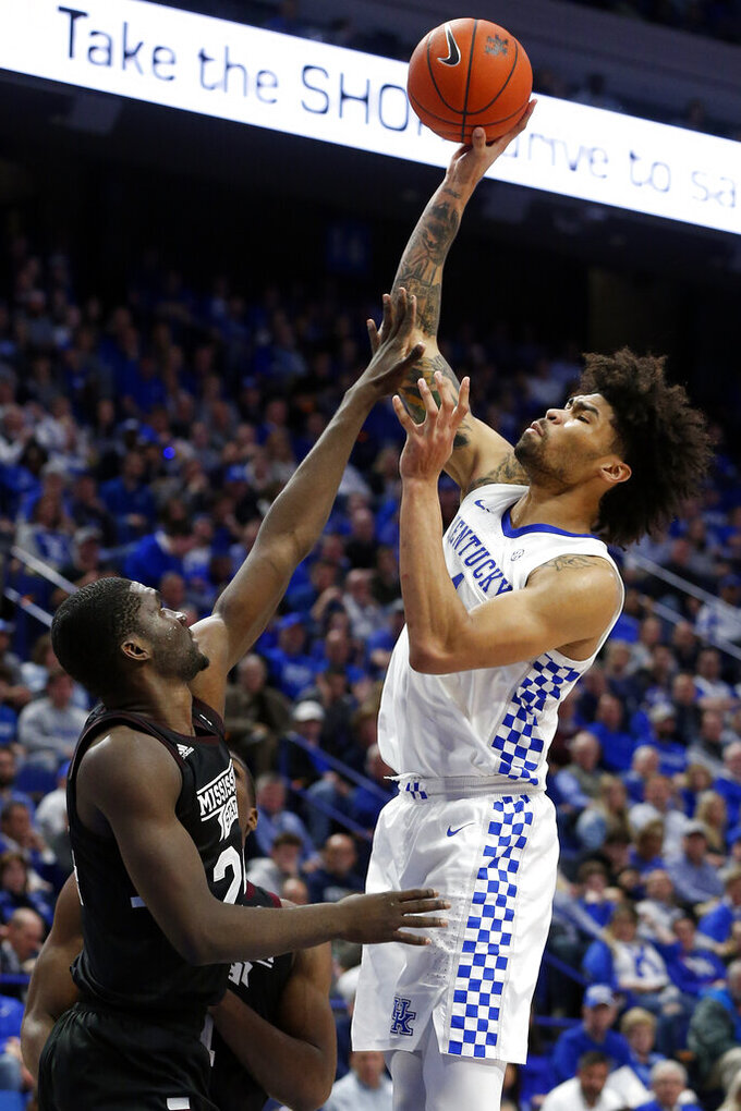 Kentucky's Nick Richards, right, shoots while pressured by Mississippi State's Abdul Ado during the second half of an NCAA college basketball game in Lexington, Ky., Tuesday, Feb. 4, 2020. Kentucky won 80-72. (AP Photo/James Crisp)