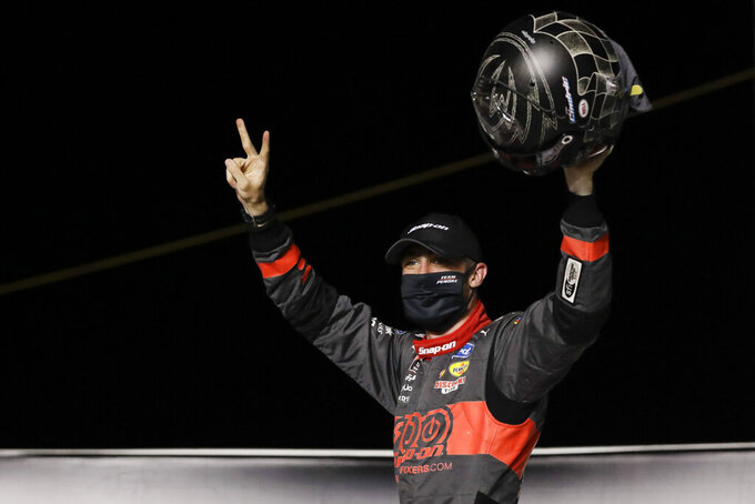 Austin Cindric (22) celebrates after winning a NASCAR Xfinity Series auto race Friday, July 10, 2020, in Sparta, Ky. (AP Photo/Mark Humphrey)